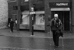Banks and Religion (Bury Gardener) Tags: ely cambridgeshire england eastanglia uk streetphotography street streetcandids snaps strangers candid candids people peoplewatching folks 2018 monochrome mono bw blackandwhite