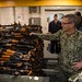 Vice Adm. Scott Stearney looks at a cache of over 2,500 AK-47 automatic rifles seized during maritime security operations.