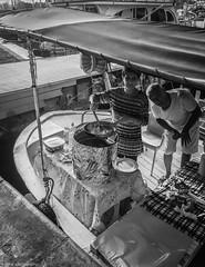 cooking on the boat (zeNat Photography) Tags: noiretblanc schwarzweiss candidshot candidphotography candid street streetlife streetphotography sea boat cooking fish monochrome blackwhite bw bnw blackandwhite