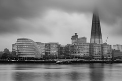 Dark clouds hanging over, all this deal or no deal talk... (Aleem Yousaf) Tags: deal nodeal brexit dark clouds looming city black white monochrome river thames hall greater authority silver shine water reflections muted talk lee neutral density filter little stopper long exposure skyline cityscape modern buildings architecture morning contrasting grey sky shard d810 nikkor nikon cloudy smooth more london united kingdom camera digital outside outdoor world photo walk photography skyscraper glass steel tower hanging fun day downtown pretty home autumn october texture