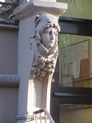 Woman with High Collar Gargoyle Next to Door Way 4847 (Brechtbug) Tags: woman with high collar gargoyle next door way front exterior building entrance new york city near 9th ave west 21st street nyc 2018 gargoyles statue sculpture man portrait art downtown stone terracotta tile artist portraits 20s area w women slope low nose november 11122018