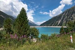 Alpine lake (Piotr Grodzicki) Tags: alps austria mountains summertime lake