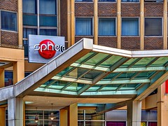 urban_chic (gerhil) Tags: architecturalphotography architecture building exterior detail lines shapes entry glass steel color sign graphic cleveland cle downtown urban city design wall angle curve shape geometry texture