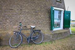Leaning on the Windmill (cheryl strahl) Tags: netherlands holland bikes europe windmills kinderdijk window bike
