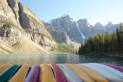 Colorful Boats (Bonsai_Photos) Tags: pine nature water panorama hill loneliness panoramic tree alberta uninhabited boat canoe lonely moraine outdoor fir alone lake ship scene idyllic scenery landscape steep forest scenic glacier quiet canada america lonesome morainelake green