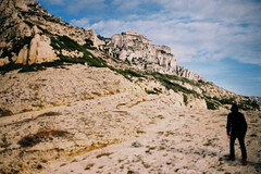 the ascent (asketoner) Tags: walking hiking mountains cliffs sky clouds rocks black hood hiker walker lonely winter marseille calanques national park marseilleveyre