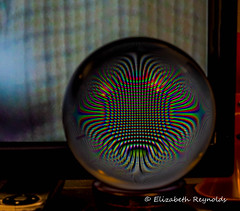 Day 274. (lizzieisdizzy) Tags: table tabletop crystalball globe glass distortion reflections pattern kaliedescopic tv television dof depthoffield dark abstract