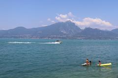 Italy - Part 10 (lucy★photography) Tags: lakegarda lake italy italian summer landscape summerweather warmth 36degreesc blowupcrocodile lilo boattrails boat