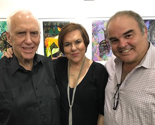 Monty Trainer with curator Lilia Garcia and artist Xavier Cortada at the opening of Xavier's exhibit at the Coconut Grove Arts Festival gallery