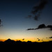 Wide view of colorful sunset behind Guatemala's volcanoes