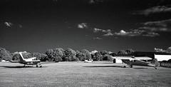 Light Planes on Infrared Film (Neal3K) Tags: bw blackwhite candlerfield georgia jchstreetpan400 nikons335mmfilmcamera williamsonga filmphotographyproject filmgrain