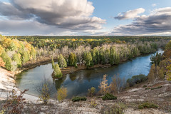 Flash In the Pan (Aaron Springer) Tags: michigan northernmichigan manisteeriver woodland forest trees river water clouds sunlight reflection october autumn fallcolor outdoor nature landscape