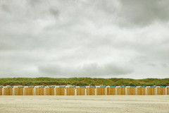 Row of Huts (Ralph Graef) Tags: hut beach sand travel horizontal holland netherlands clouds holiday calm tranquility boredom coast