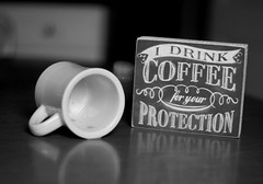 Coffee... For Your Protection (photo_secessionist) Tags: coffee cup caffeine sign philosophy blackwhite monochrome bw bn pentax km pentaxaf250mmlens 50mm primelens drink stilllife