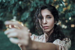 Air sounds like the silence (Enrico Cavallarin) Tags: natural nature girl freckles curlygirl curly eye browneyes greeneyes face ritratto portrait portraiture retrato ambient portraitphotography portraitphotographer intothewild intothenature intotheforest intothewoods bokeh