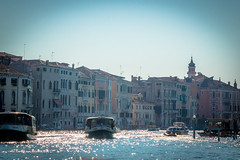 A busy waterway in Venice Italy filled with water taxis.