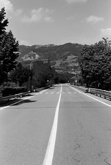 Straight road (sam.naylor) Tags: italy europe travel medium format film fuji nature mountain mountains hills countryside medieval history stone bobbio town ancient street summer warm 35mm contax g1 rangefinder colour viaduct sky bridge black white monochrime grey ilford fp4