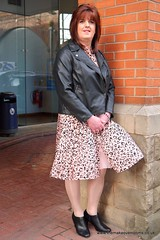 Flighty (janegeetgirl2) Tags: transvestite crossdresser crossdressing tgirl tv ts heels nylons glamour ankle boots summer shirt dress jane gee outside promenade brighton leopard biker jacket black