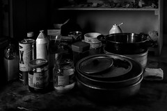 Still life in black and white (tmeallen) Tags: stilllife blackandwhite cabin hut sidelight memorabilia potsandpans jars toiletpaper shelf rocks interior remote travel culture heklahavn denmarkisland scoresbysund eastgreenland