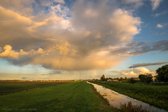 Isolated Autumn Shower with Rainbow (mesocyclone70) Tags: shower storm rainbow landscape holland colors colorful scenic thunderstorm therebeastormabrewin stormchase evening sunset