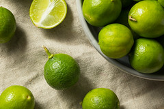 Raw Green Organic Key Limes (brent.hofacker) Tags: agriculture background citric citrus crop food fresh freshness fruit green half harvest health healthy ingredient juice juicy key keylime keylimes leaf lime limes natural nature nutrition organic plant produce raw refreshing ripe sliced sour tropical vitamin
