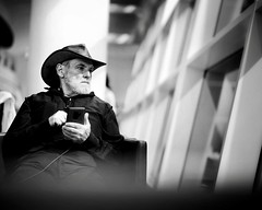 Airport Lounge Cowboy (jameswilkinson1) Tags: streetportrait street blackandwhite bnw window man light hat portrait people cowboy lounge airport