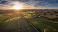 Sunset at Síd in Broga (mythicalireland) Tags: sunset setting sun drone dji phantom evening autumn clouds sky landscape shadows trees fields grass road monument megalithic neolithic stone age boyne valley meath river aerial