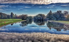 A stunning reflection!😀 (LeanneHall3 :-)) Tags: sunrise lake reflection water trees green leaves branches grass blue white clouds talkativeclouds cloudsstormssunsetssunrises bridge sky skyscape eastpark hull kingstonuponhull samsung groupenuagesetciel