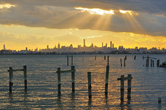 Rays of Hope (Lojones13) Tags: sunlight rays waterfront clouds cloudy waterscape newyorkcity skyline nikond300s piers