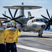 Sailors spot an E-2C Hawkeye aboard USS George H.W. Bush (CVN 77).