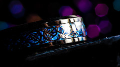 Macro Ring (CarnivoreDaddy) Tags: ring bokeh macro closeup lowlight lowkey speedlite dutchangle dutchtilt tilt stilllife macrolens dslr nikon d7000 celtic pagan goth nordic norse jewelry detail knotwork tamron tamron60mmf2 raw lightroomcc