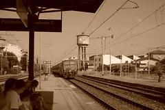 Binario   ∞ / To North East (AliceFerretti) Tags: seppia train stazione italia trenitalia railway stations people viaggi turism pendolari afa estate summer 2009 transit momento platform piaggio cisterna nikon