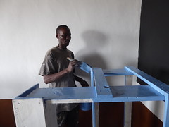 Final coat for the desks (prondis_in_kenya) Tags: kenya nairobi colddryseason tujisaidie school kayole udp kuvukadaraja urbandevelopmentprogramme asc painter paint desk blue