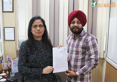 Ms. Parwinder Kaur (Director of West Highlander) handing over New Zealand Student Spouse Visa to Gurinder Singh