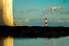Lighthouse (Sir snap) Tags: lighthouse sea rocks reflection weed beachy head shore water