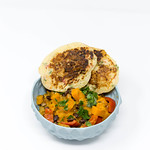 Hello Fresh - Carribian Sweet Potato Coconut Stew with Black Beans and Tasty Bananapancakes in blue bowl on white background thumbnail