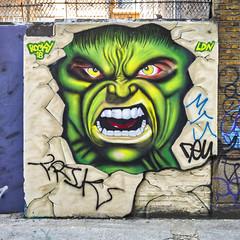 Grrrrrrrr (f22photographie) Tags: streetart street scene streetscene urbanart urban wall brickwork colourful monsters green face facialexpression teeth piercingeyes corbetplacelondon