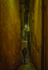 Vicolo Purgatorio (Tiigra) Tags: cefalù palermo italy it 2018 architecture cefalu lantern light medieval monochrome night passage person rhythm road ruin sicily stairs town wall