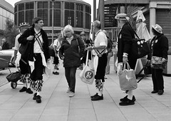 Joining the Morris Dancers (Bury Gardener) Tags: burystedmunds bw blackandwhite england eastanglia uk britain 2018 snaps suffolk streetphotography street streetcandids candid candids people peoplewatching folks arc thearc