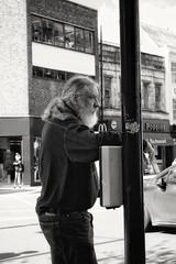 The waiting is the hardest part. T.Petty. (ianmiller6771) Tags: streetphotographyuk ukstreetphotography monochrome blackandwhite whiteblack candid worcesteruk fuji roadcrossing beardedman ponytail