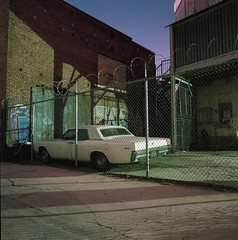Continental (ADMurr) Tags: la eastside white continental lincoln night car fence urban hasselblad 500 cm 50mm zeiss distagon dad228 ektar kodak 120
