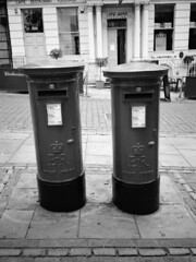 """""""You're waiting for ages and then two come along at once"""". (Esmik D'Aguiar) Tags: post box street road pavement shop mono nottingham uk british fujifilm ga645zi neopan 400 column brick door window city pillar"""