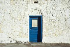the blue door. death valley junction, ca. 2018. (eyetwist) Tags: eyetwistkevinballuff eyetwist blue door peeling paint hotel amargosahotel deathvalleyjunction mojavedesert california nikon n90s nikkor 28105mmf3545d 28105mm kodak ektachrome e100 100 35mm new transparency chrome slide nikonn90s kodakektachromee100 ishootfilm ishootkodak analog analogue film emulsion coolscan iconla southwest usa deathvalley junction mojave desert amargosa opera martabecket historic landmark borax entrance sign typography lettering adobe window wall building weathered worn decay minimalist