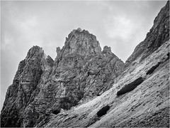Twins and more... (Ody on the mount) Tags: anlässe berge dolomiten em5ii felsen felswand filmkorn fototour mzuiko6028 omd olympus rahmen urlaub wolken bw clouds monochrome mountains quadratisch rocks sw vertical vertikal