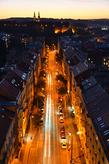 Late evening view over Jaromirova street in Praha 2 district (Pavel's Snapshots) Tags: stream street night evening late dusk orange blue sky roofs houses traffic direction straight distant density prague praha czech czechrepublic bridge nikon d750 50mm historic historical rail valley vysehrad urban city town haze dramatic vivid colorful saturation architecture traditional view landscape cityscape road way contrast flow lights tileroof autumn trail vertical bright illumination cars