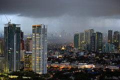 Rain rain rain (Sumarie Slabber) Tags: red rain raining city cloudy citylights buildings sumarieslabber manila philippines weather storm