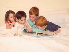 Captivated... (elaine.smith101) Tags: makingmemories memories bedtime nikond7000 nikon redhead redheads cousins storytime book imagination children kids people
