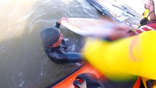 Porthcawl RNLI rescuing a windsurfer who had suffered equipment failure.