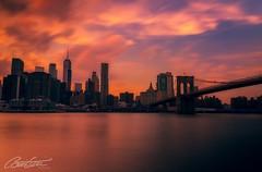 Brooklyn Bridge sunset 🌇 (corineouellet) Tags: waterreflect reflect reflet oceanview clouds cloudy cityscape city canoncanada canonphoto canon slowshutter longexposure longueexposition longexpo sunsets sunset bridge brooklynbridge brooklyn