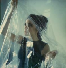 (Matteo-Palmieri) Tags: polaroid sx70 analog film square grain girl portrait light veil plastic